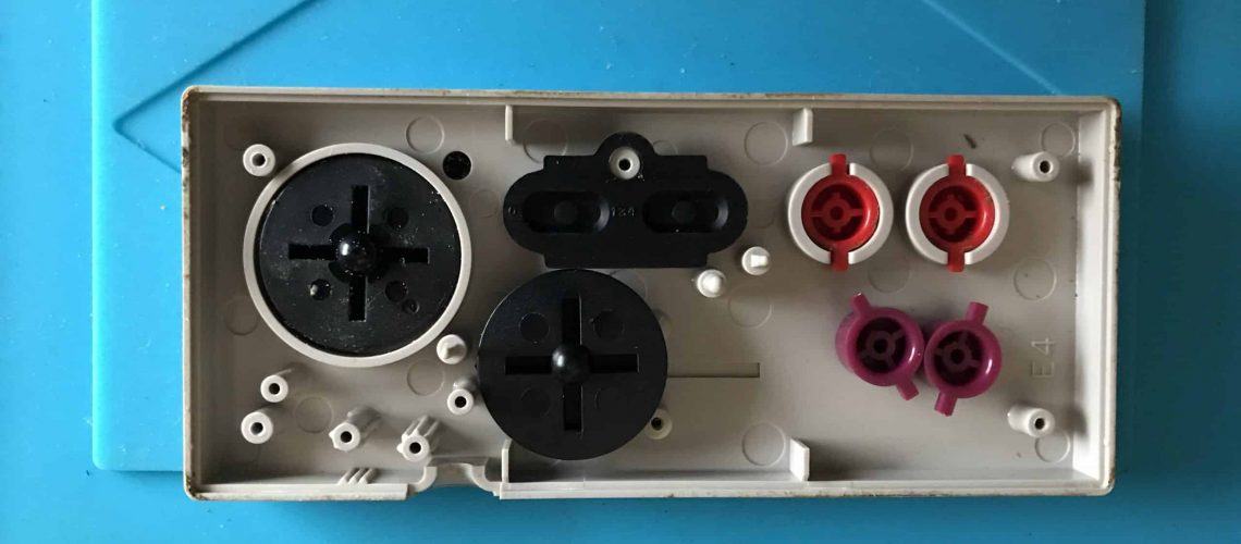NES controller open with different buttons
